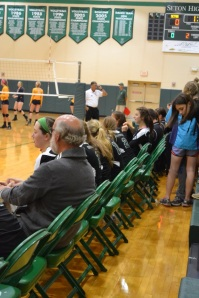 Mr. Kellerman sits with the team
