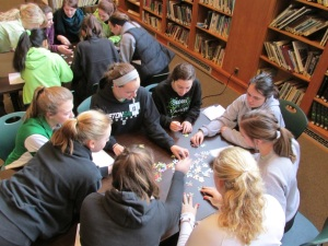 A group working together to complete a jigsaw puzzle