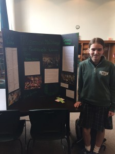 Freshman Emma Ochs stands proudly by her final product on Roman Holidays
